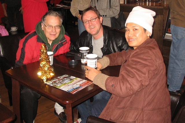 GOOD FRIENDS--Two years after attending their wedding, Jack Sproule enjoys coffee in Sidney with Daniel Gawthrop and his husband, Lune. Christmas, 2007